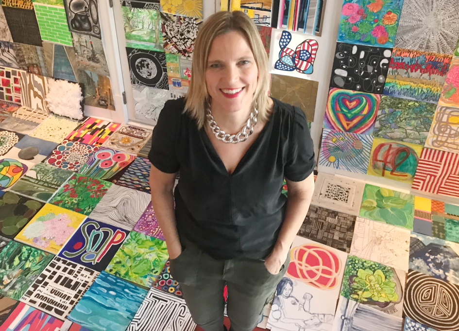 Artist and editor Kathryn Hempel with a few of the 365 paintings she completed in 2018 (photograph by Betsy Grimm).